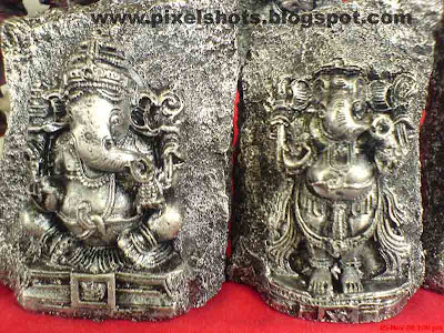 lord ganesha small carving in metal photograph