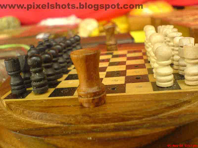 chessboard made of wood,small wooden chessboard for sale in a shop in cochin mattancherry