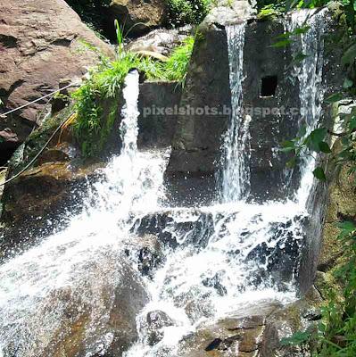 small waterfalls in kerala,seasonal waterfalls seen aside roads in kerala,waterfalls and streams in kollam district of kerala,thenmala mountsin streams flowing into river kallada