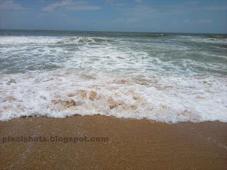 kerala beach photos in monsoon season. varkala beach waves during september.white beach wave
