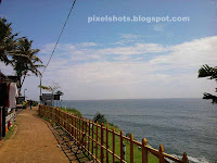 varkala cliff top walking lane,walkway through beach cliffs in india kerala,varkala photos,sea side walking lanes,arabian sea