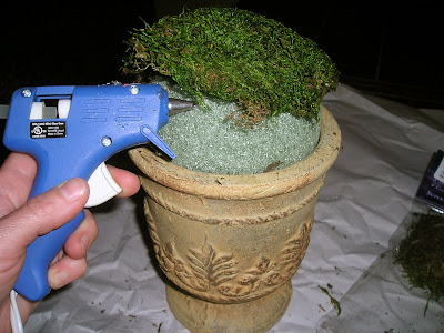Use hot glue and a foam ball to make a moss topiary
