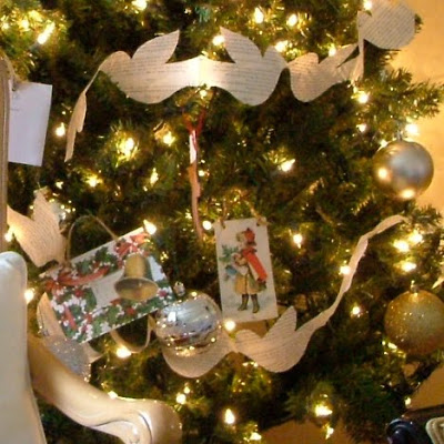 Pretty paper dove garland with old book pages