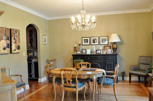 Dining room before. Staging this space so it was balance makes all of the difference.