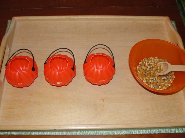 Spooning Corn into Miniature Jack-o'-Lanterns (Photo from Olives and Pickles)