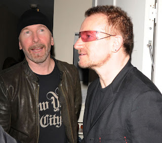 Bono y Edge en la fiesta por darfur