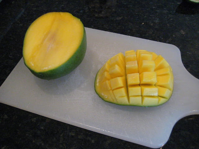 Cutting up mangoes for salsa recipe