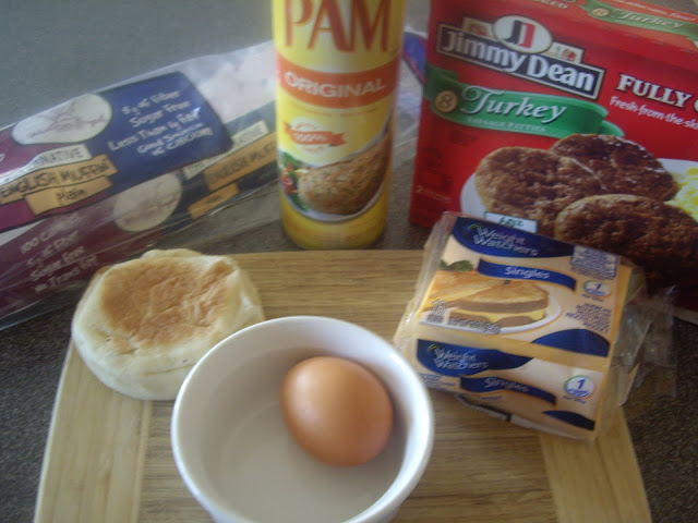 A display of needed ingredients to make an English muffin sandwich.