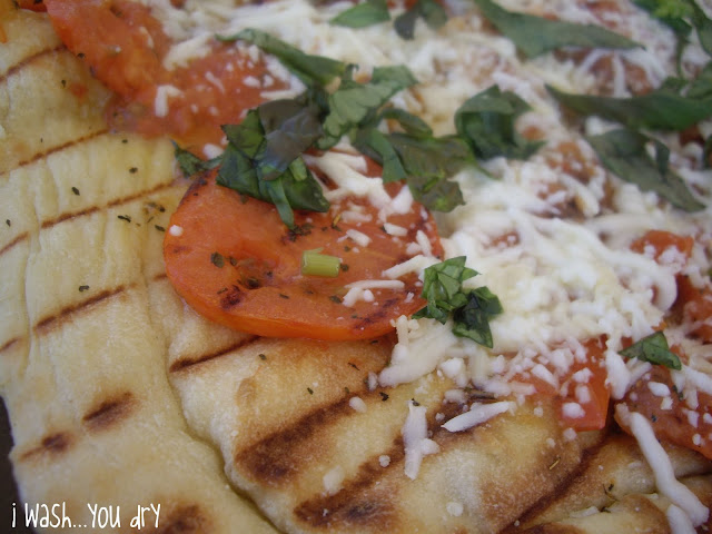 A close up of grilled pizza.