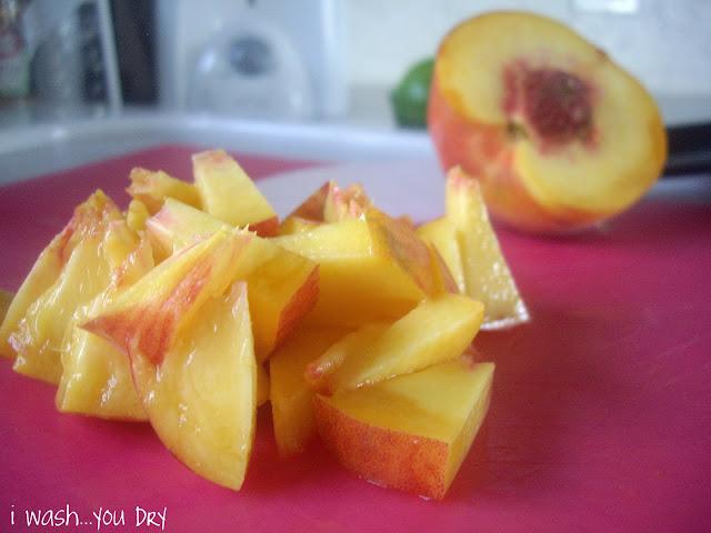 Chopped peaches on a cutting board.