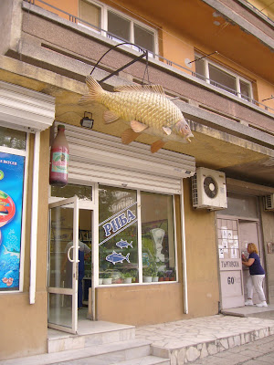 A Dangling Carp Outside A Yambol Fishmonger's Shop