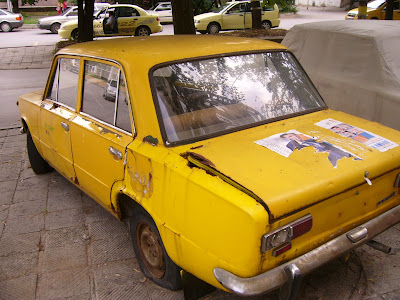An Old Yellow Lada Taxi In Yambol City Centre