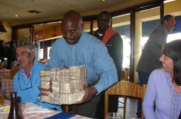 Bricks Of Zimbabwe Bills To Pay For A Meal At Restaurant