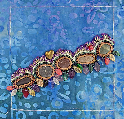 bead embroidery by Robin Atkins, piece in progress with pebbles in bezels