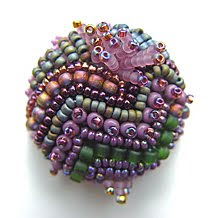 beaded button by Robin Atkins, bead artist