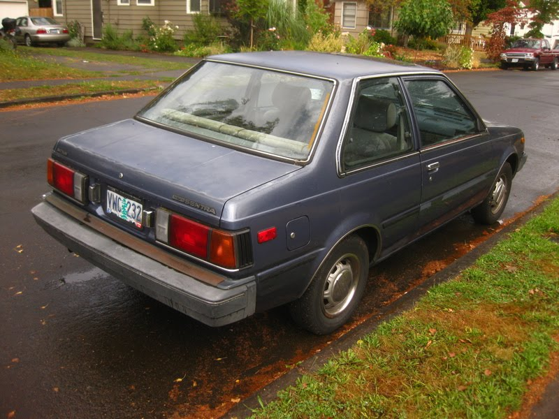OLD PARKED CARS.: 1984 Datsun/Nissan Sentra Sunroof Coupe.
