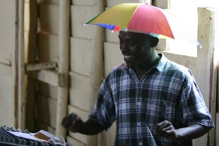 b927cb15c4c23 Dudes Wearing Umbrella Hats... Posted by Some Guy ...