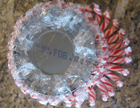 The tips of the wrappers might hang over the bottom; you can glue them down to the bottom of the jar.