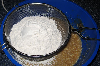 sift flour through strainer