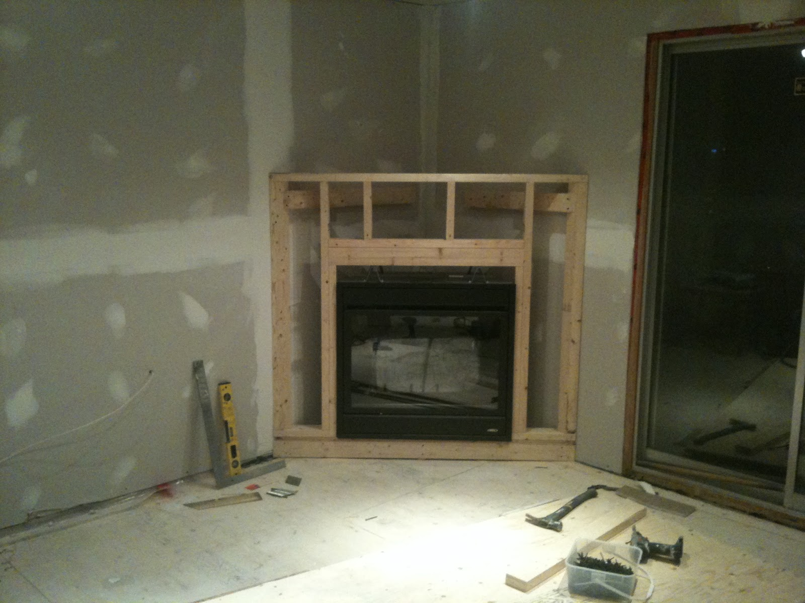 The blue house on the corner for Building an indoor fireplace