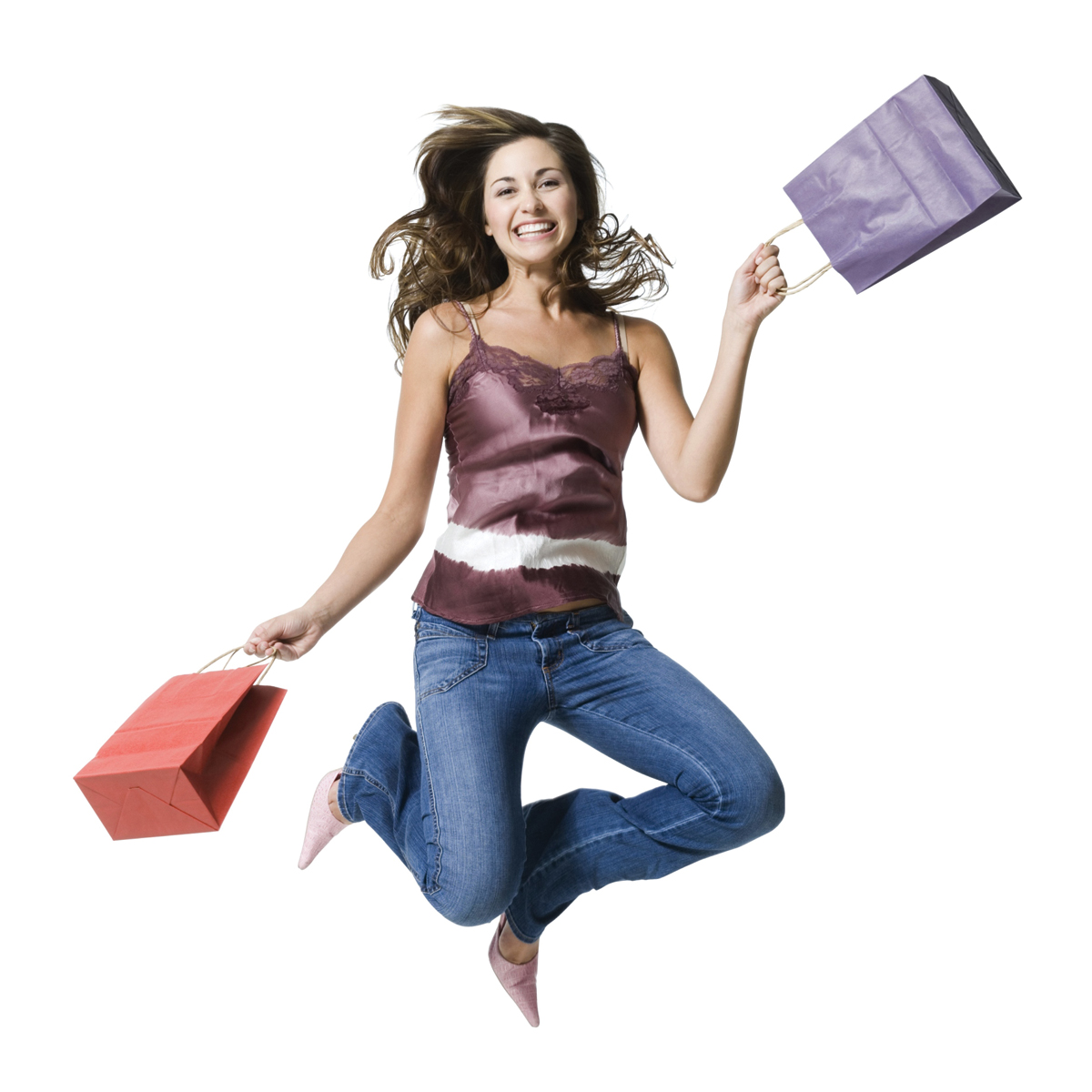 lady jumping in the air with shopping bags