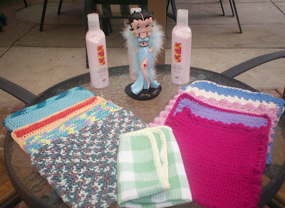 betty boop figurine along side crochet face cloths
