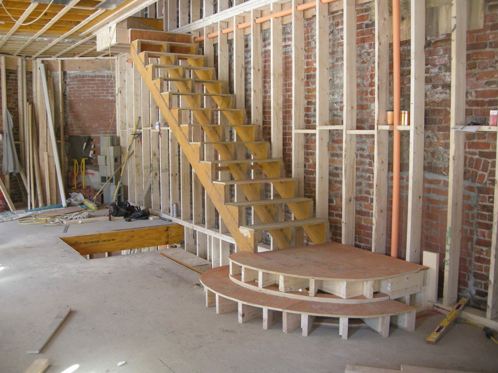 redbrickbuilding: Staircase framing begins in our unit