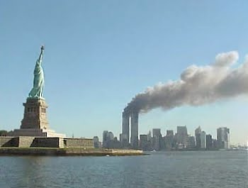 September 11, 2001 attacks in New York City: View of the World Trade Center and the Statue of Liberty.