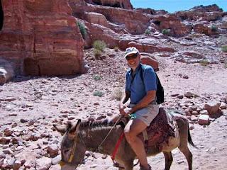 Wayne Dunlap Riding Donkey Monastery Petra Jordan