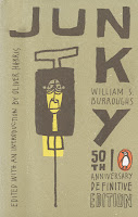 "A cover for the 50th anniversary edition of ""Junky,"" featuring a cartoon of a syringe with a face in it."