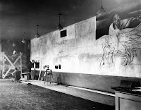 A photograph of an unfinished mural.