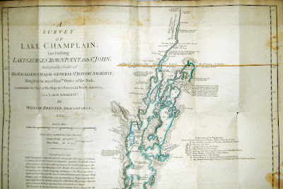 """A photograph of an unfolded map titled """"A Survey of Lake Champlain."""""""