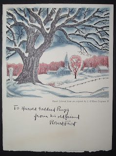A card featuring a print of a snow-covered tree with a church in the distance.