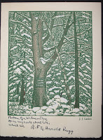 A card featuring a print of trees in snow.