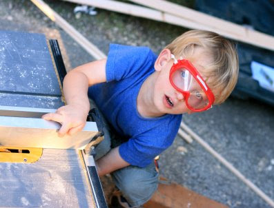 NAMC montessori summer activities woodworking boy in goggles