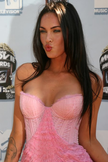 megan fox waring a pink bodice showing her breasts