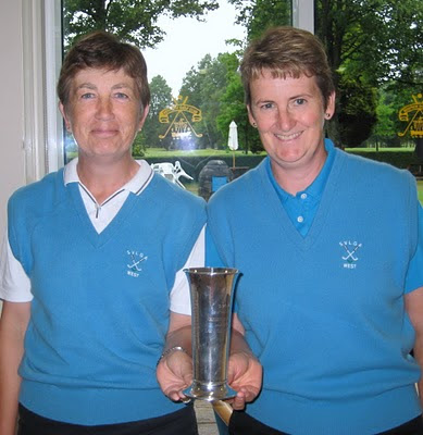 Alex and May hold the West Vets Trophy