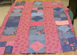 Pink and blue quilt top