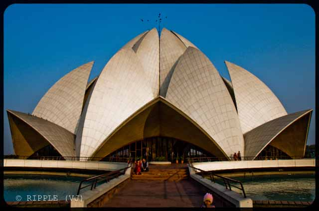 A good place to visit in Delhi : Lotus Temple @ Nehru Place, Delhi, INDIA: Here are some some miscellaneous shots of Lotus Temple. The construction of the temple is similar to that of the Opera House in Sydney. The temple always looks mesmerizing. However, different light conditions have different effect on the way the temple appears.: Posted by Ripple (VJ) on PHOTO JOURNEY @ www.travellingcamera.com : ripple, Vijay Kumar Sharma, ripple4photography, Frozen Moments, photographs, Photography, ripple (VJ), VJ, Ripple (VJ) Photography, Capture Present for Future, Freeze Present for Future, ripple (VJ) Photographs , VJ Photographs, Ripple (VJ) Photography : A couple enjoying the serenity of the temple @ LOTUS TEMPLE, Nehru Place, Delhi, INDIA