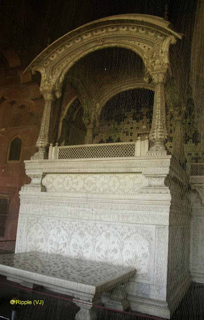 RED FORT: Diwan-i-Am or Hall of Public Audience is situated in the Red Fort of         Delhi. It originally had a courtyard on its front and was richly         ornamented with gilded stuccowork. Heavy curtains graced the main hall,         which were three bays in depth.
