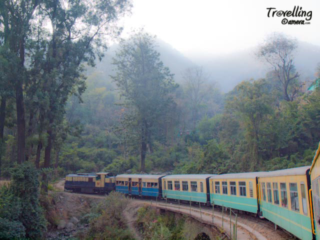 Toy Train experience on Pathankot-Jogindernagar Railway Track in Himachal Pradesh : Posted by VJ SHARMA @ www.travellingcamera.com : I have spent one day in Kalka Shimla Toy train and few days back I had chance to travele in Pathankot-Jogindernagar Toy Train... Here are few photographs of that journey...Pathankot-Jogindernagar Toy Train crossing a bridge near Kangra....The distance of Pathankot from Kangra is 96 kilometers and  Jogindar Nagar from Kangra is 69 kilometers... This toy train takes more time than normal plain area time as it travels at very low speed and as it is a single line so train stops to give passage to trains from other direction. The train passes through valleys, rivers, many beautiful towns and towards the last stretch of the journey having clear view to snow covered Dhauladhar mountain ranges...Narrow track for Pathankot-Jogindernagar Toy Train...Railway Track near Aehju which is a small railway station near to Bir Billing...Railway junction to give pass for other trains coming from other direction... Its single lane and narrow-gauge track...This is of course a different experience as compared to other journeys in  Toy-Trains... If I compare it with Shimla Toy Train, chances of view to snow capped hills is less in case of Kalka-Shimla Toy Train... On this route there are some beautiful tea-gardens... On the other side Shimla-Kalka toy trains passes through various tunnels which is altogether a different experience...More details about trains on this route are available @ http://www.himachalpradesh.us/himachal/himachal_train2.php : I recommend reconfirming these details from IRCTC always... I have seen changes in schedule many times....As the train moves upward and this journey becomes more scenic with a distance view of snow capped Dhauladhar mountains..... Rivers become narrower with deep blue water and the train starts taking curves on hieghts... There are few tunnels in this track in comparison to Kalka-Shimla route...Toy Train passing through Pine Forests..