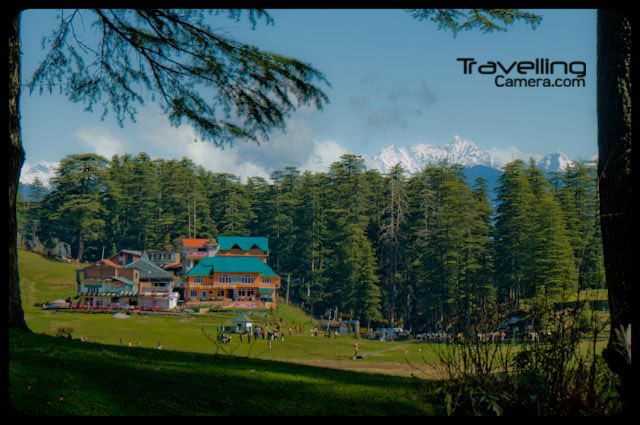Mini Switzerland of Hidustan : Khajjiar in Himachal Pradesh state of INDIA: Posted by VJ SHARMA at www.travellingcamera.com : I have been to Khajjiar many times but the very first trip to this place was very exciting. We spent 5 days in Dalhousie and had trekking experience of various places around Dalhousie like Kala-Top, Dainkund, Khajjiar-to-Dalhousie... We went to Khajjiar by Bus and came back through various treks on the way... Here are few photographs of Khajjiar which is also known as Mini Switzerland of India...A government building on one side of Khajjiar Lake...We can early in the morning by first bus from Dalhousie to Chamba via Khajjiar... It was calm in the morning and after few hours it was so much crowded that 20% of this huge lake was covered with tourists and children...Vew of same building from other side of Khajjiar Lake @ Chamba Distrct of HimachalPradesh, INDIAWe enjoyed some chit-chat inside the lake and after some time few of us were not very excited about the idea of spending more time at Khajjiar... An Idea came in for going back to Dalhousie on feet... Some of us were not confortable with the idea but finally all of enjoyed various treks on the way back to Dalhousie...Horses standing on one side of Khajjiar Lake.... waiting for tourists who want to have a ride around this lake... Chatk is very famous and tallest horse here... Pure White... We also had a ride and in the end I was able to control that horse :-) ... I mean I got to know how to stop, give directions, move fast etc...Partial view of Khajjiar Lake from outer path of the lake where horses move to complete the circular round around this lake...We had early lunch at Khajjiar and started back journey with some snacks & dricks in our backpacks...A Narrwo view to some resturants on one end of Khajjiar Lake...Hiding behind huge Deodars around Khajjiar Lake... From this place we started our trekking back to Dalhousie... Till Dalhousie, we needed to climb -lot many hills and few road-walks where climbing was not possible....