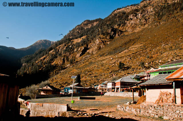 Wondeful stay at Sarahan Village of Kullu District of Himachal Pradesh (During MTB Himachal 2010) : PART-1 : Posted by VJ SHARAMA on www.travellingcamera.com : During the Mountain Terrain Biking Himachal 2010 we reached Kullu Sarahan on third day and fourth day was rest day... All of us spent a wonderful day in Kullu Sarahan village... During fourth day we also went for a trek and here are few photographs of our stay at Kullu Sarahan Village on fourth day ... Check out !!!There was a colorful temple in the middle of Sarahan Village.... Due to some reasons it was closed and we were not able to see it inside...Kullu Sarahan village has a beautiful landscape and a government HPPWD rest house. During july/august/september, many folks reach the village for trekking and some of these trekkers stay at the rest house near a huge ground in the village... Its like a valley on top of hills... There is a popular trek from Kullu Sarahan to Bashleo Pass which passes through dense jungles, various waterfalls and green meadoThere was a small open area outside the temple where fair happens every year and many gods from neighboring villages come here to meet each other... Their is a tradition of gods in upper Himachal where most of the villages have their own Gods and even these gods have relationship with each other... There are some defined occasions when they meet each other....Bashleo Pass is a near is a mountain pass located at an altitude of 3300 meters. It connects Kullu Sarahan to Bathad. Bashleo pass opens in April till November. In winters, the route is closed due to heavy snowfall in this region. However locals people might trek during clear days in winters as well but trekking for amateur trekkers is not advisable during these months. The pass is located at a distance of approximately 6 kilometers from Bathad and 5 kilometers from Kullu Sarahan village...ws...Here is a photograph of local container used for bringing crops to home.... They tie it on backs and keep cutting crops... When its full, crops are brought to home.... I had asked one lady about the name of this particular thing but forgot now.... This is created by Bamboo sticks and their are some experts in Himachal who can create anything out of Bamboo (Doomna Community)...Most of the houses in Sarahan Village are made up of wood and stones...  Sharp sunlight hitting one side of the house and most of them were facing a deep valley in front of snow capped hills of Bashleo Pass ...Sweet children in th village... some of them were following us to know what these guys are doing inside the village... Few of them were teasing one of the photographers with fireworks... It was Diwali time and they were spending most of the time near shops having lots of crackers...Shining Electricity Towers in Sarahan Village @ Kullu, Himachal PradeshSarahan Village is rich in terms of resources... Electricity without cuts, fresh water available 24 hrs and whole village has solar panels...Here is one of the solar panel at the entry of Sarahan Village...All these photographs have been clicked during Mountain Terrain Biking event in Himachal Pradesh (23rd to 30th October,2010)