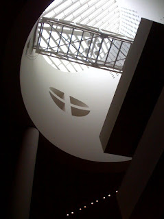 view up into the lightwell of SFMoMA, phone photograph by A.E. Graves