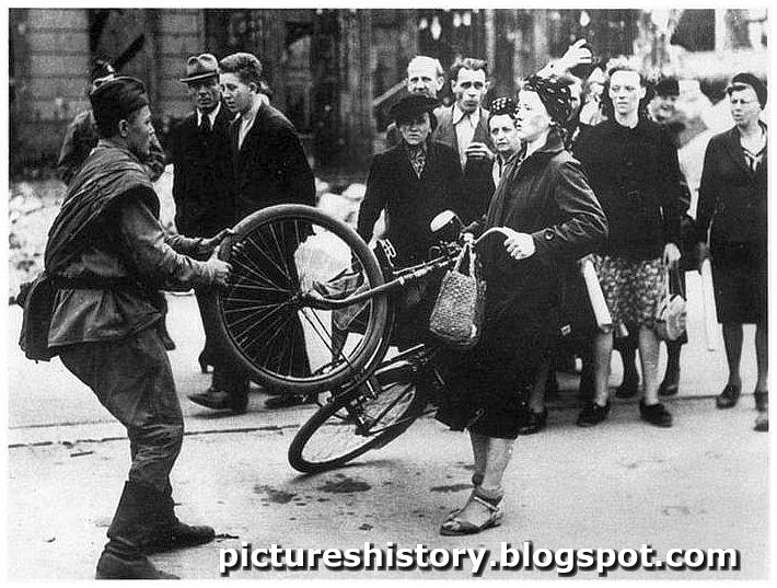 Red army soldier harasses German woman bicycle