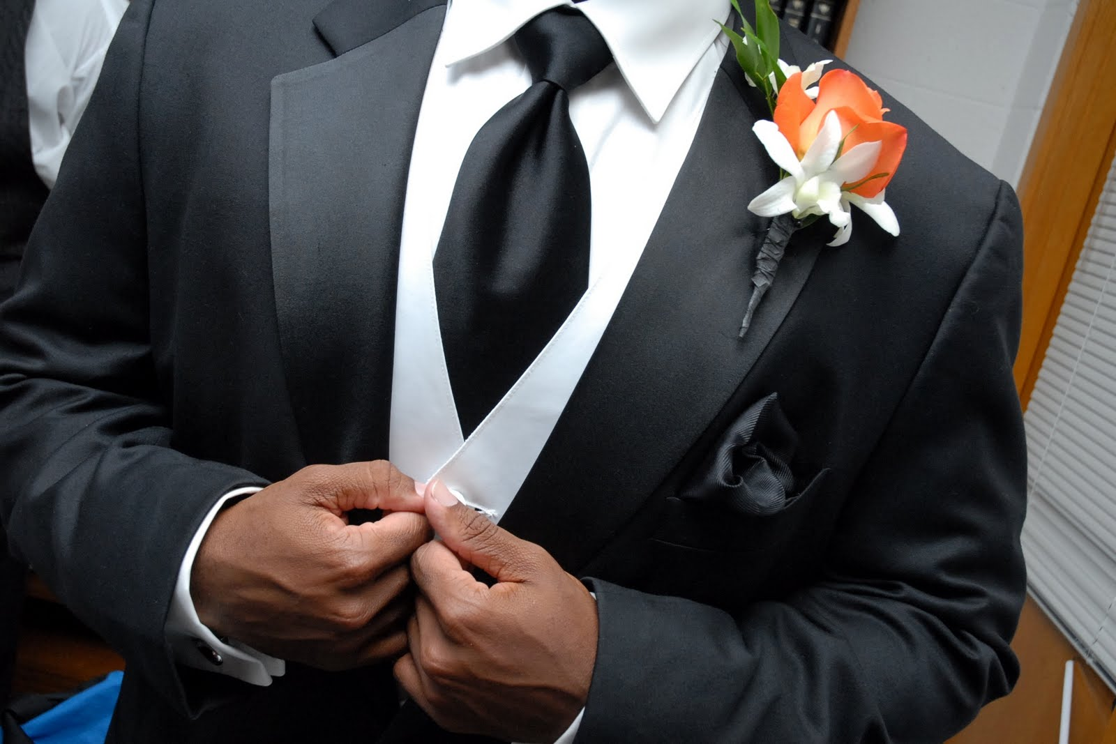 Pocket Square and boutonniere for groom and groomsmen at wedding