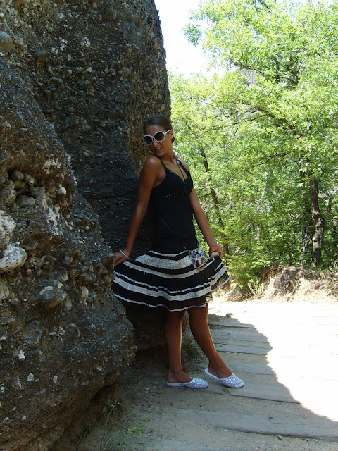 black top black skirt with white lace white sequined slippers white sunglasses