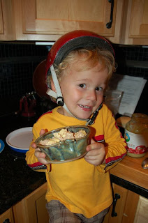 My oldest son Michael, several years ago, making his own organic apple cobbler in a handmade pottery dish, a gift from his great grandmother