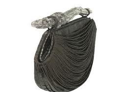 20afee065 10. Leiber Dandelion Suede Gator Handbag: 15 mil dólares (10.925,33 €). El  bolso más barato de la lista, también perteneces a la marca Judith Leiber,  ...