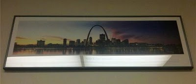A framed picture of St. Louis at the Yale School of Management